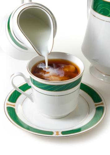 Tea with milk being poured